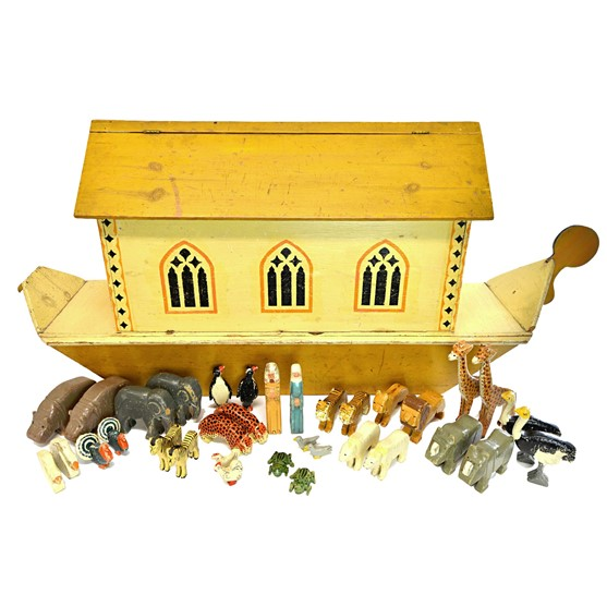 A polychrome decorated wooden toy model... Image
