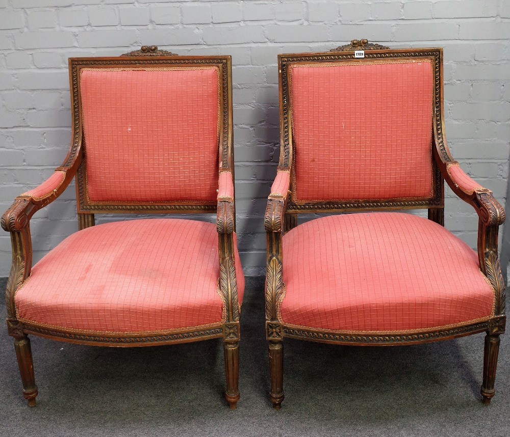 A pair of Louis XVI single square back open arm fauteuils, on tapering fluted supports, 71cm wide... Image
