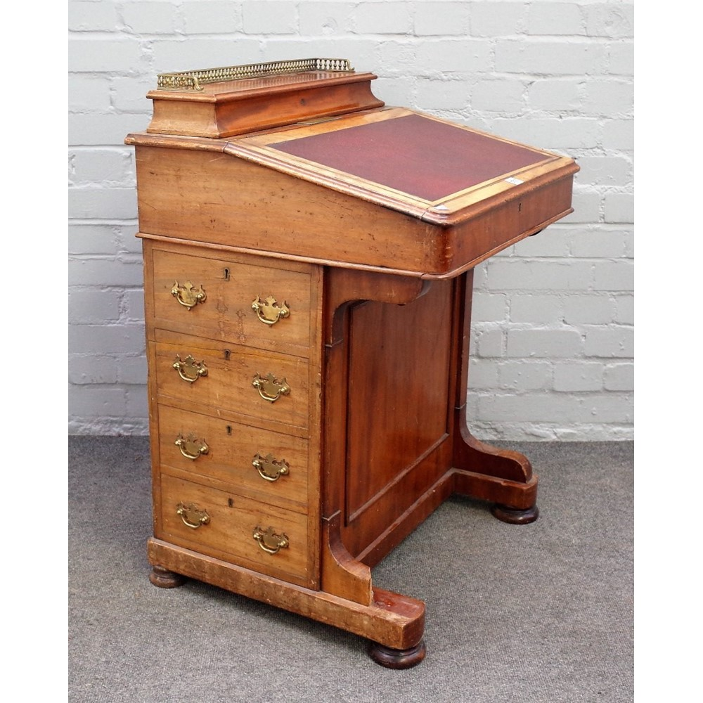 A Victorian mahogany Davenport with fitted galleried super structure over sloped front and four... Image