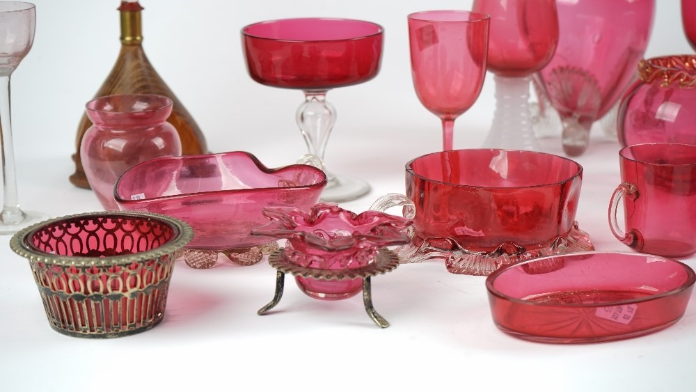 A group of cranberry glass, late 19th century, including; vases, bowls, dishes, a milk jug and... Image