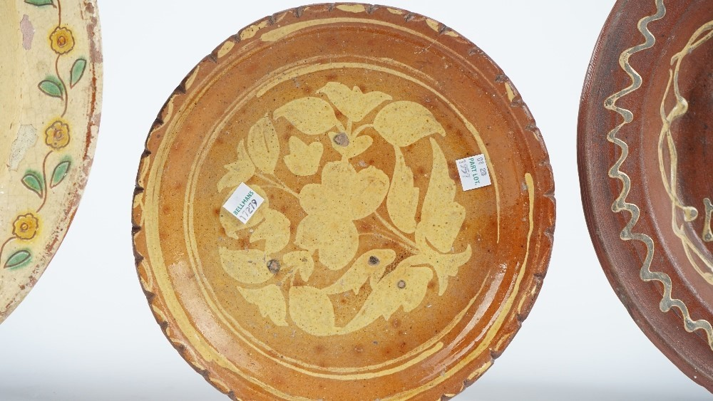 A large Continental slipware bowl, late 19th/early 20th century, incised with two yellow birds... Image