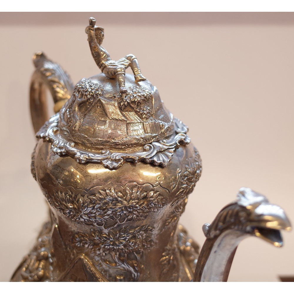 A Victorian silver coffee pot, of baluster form, the body and the hinged lid decorated with Dutch... Image