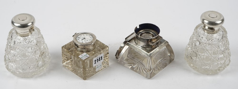 A silver mounted square glass inkwell, Birmingham 1911, the top mounted with a keyless wind,... Image