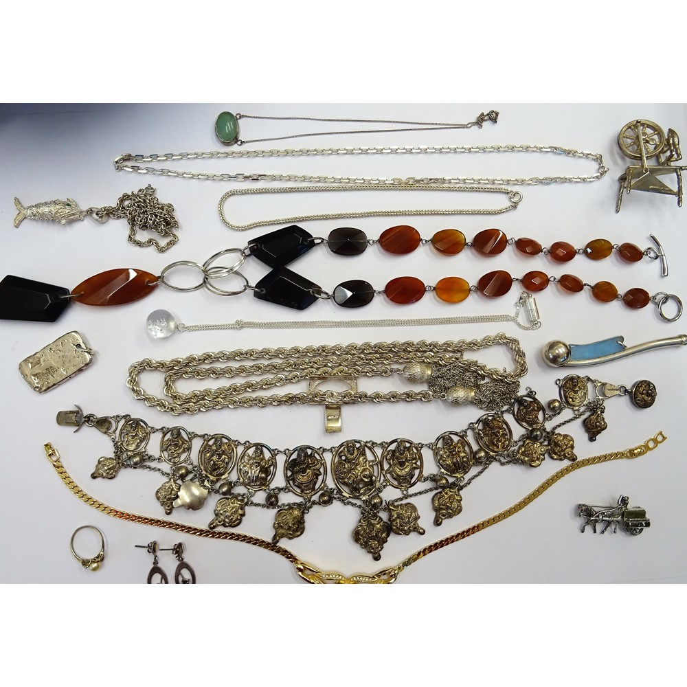 A group of silver and other jewellery, comprising; a necklace having pendant drops, probably... Image