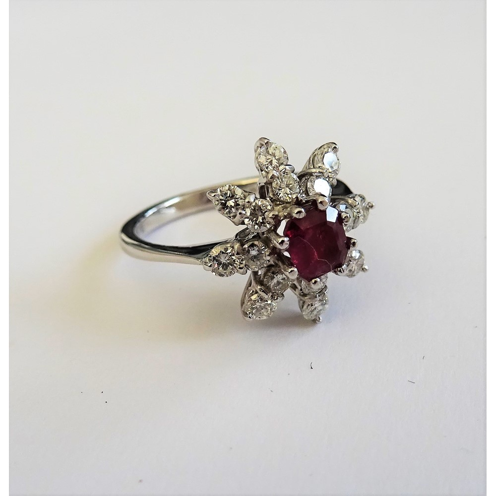 An 18ct white gold, ruby and diamond ring, in an eight pointed star shaped design, mounted with... Image