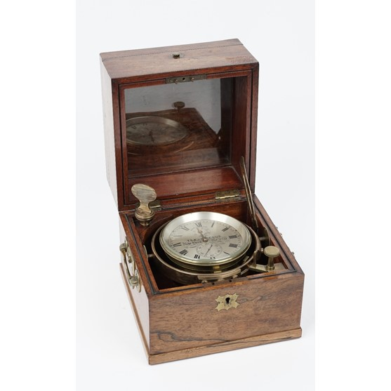 An interesting American walnut cased two-day marine chronometer by T.S. & J. D. Negus, New York,... Image
