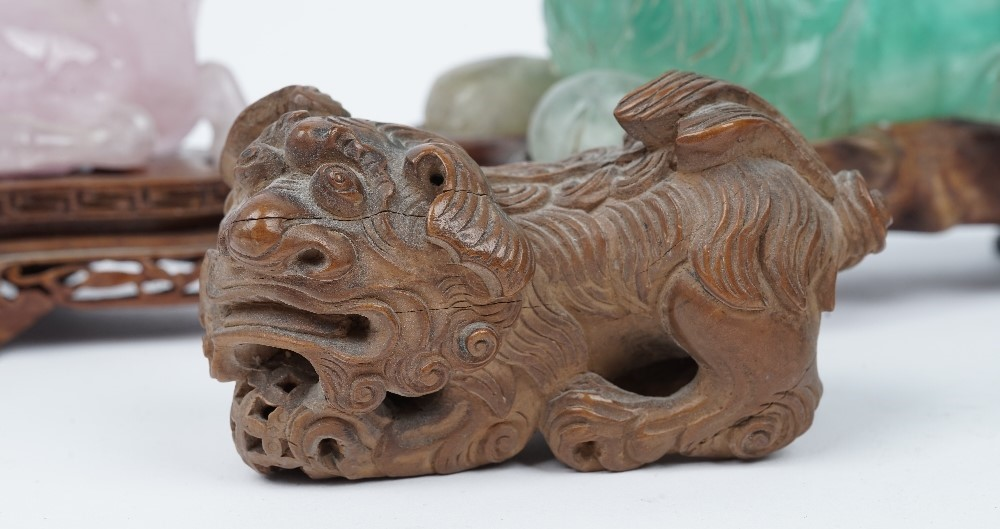 A group of modern Chinese collectables comprising; a pair of carved wooden dogs of Fo, 9cm, a... Image