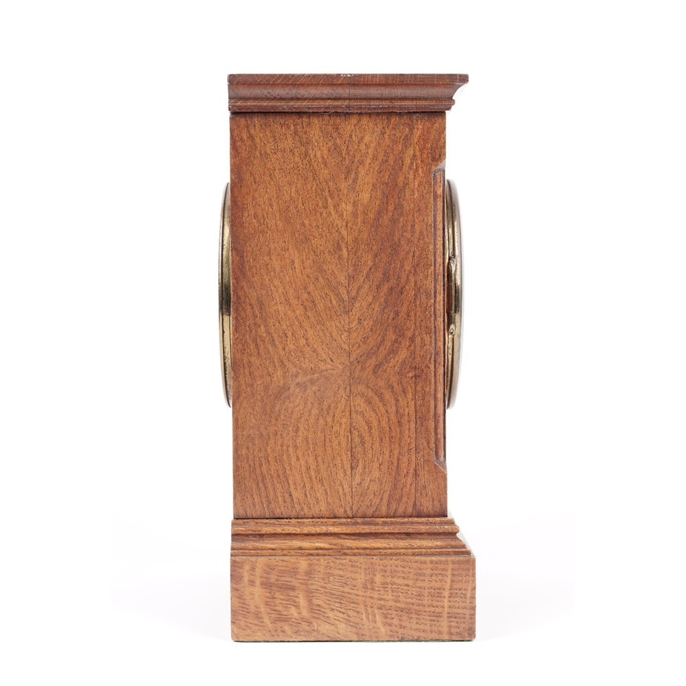 An Edwardian oak cased mantel clock with visible brocot escapement, and a French two train... Image