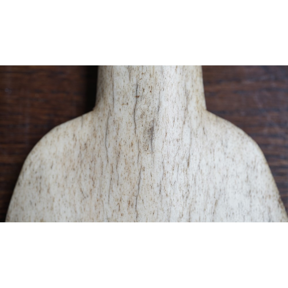 A 19th century whalebone Maori club or Kotiate, the handle terminating in a carved tiki maskette,... Image