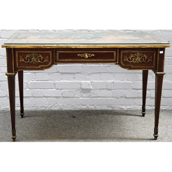 A Louis XVI style mahogany ormolu mounted bureau plat, stamped Mellier & Co, London, with inset... Image