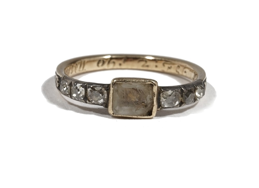 A Georgian yellow precious metal mourning ring, set with a central plaque between diamond set... Image