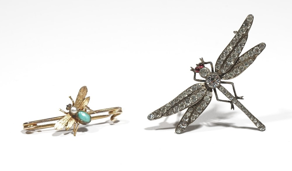 A yellow precious metal, seed pearl and turquoise set bar-brooch designed as a bee in flight,... Image