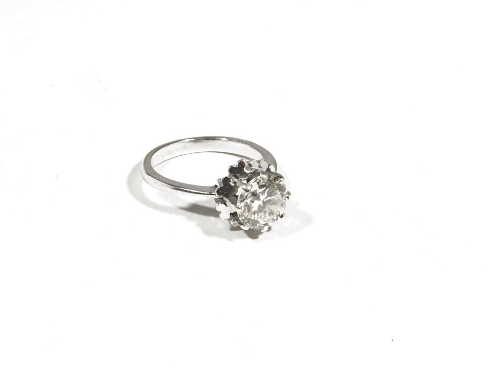 A single stone diamond ring, the brilliant-cut diamond approximately 2ct, eight claw illusion-set... Image