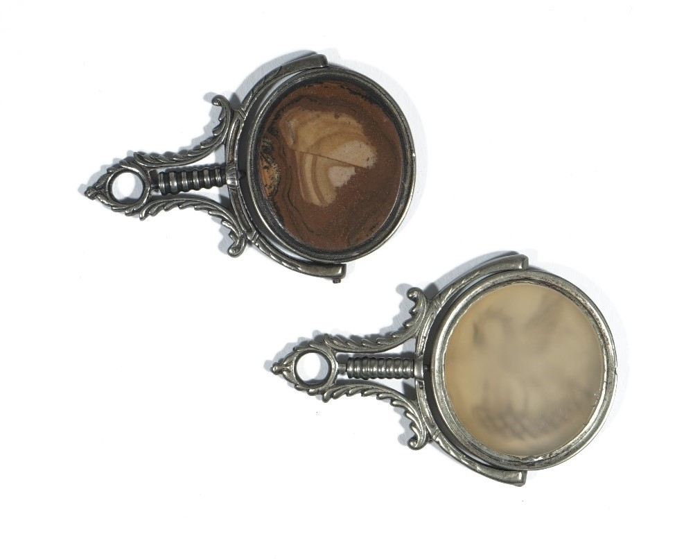 A late 18th/early 19th century brown agate set swivel fob, intaglio carved with bust of a bearded... Image