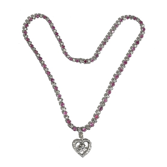 A diamond and pink sapphire pendant necklace, the front pendant drop claw set with the principal... Image