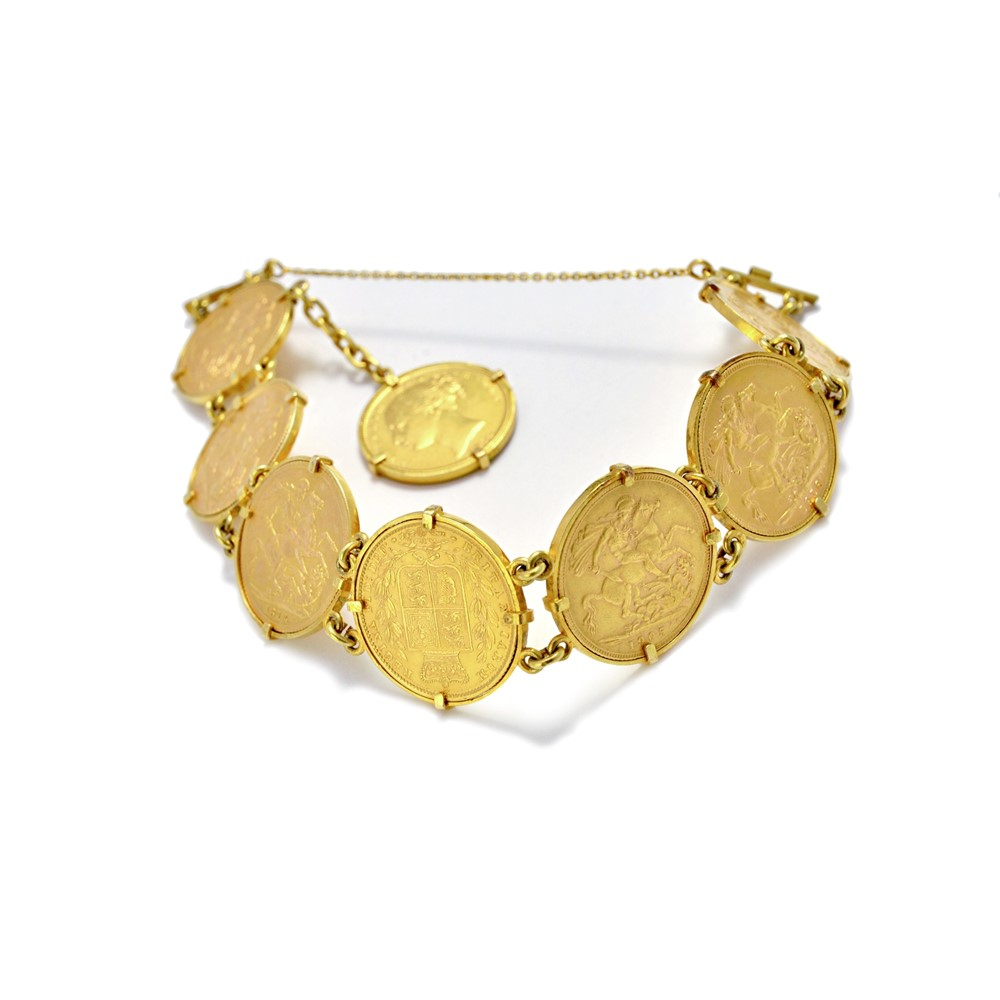 A gold bracelet mounted with eight... Image