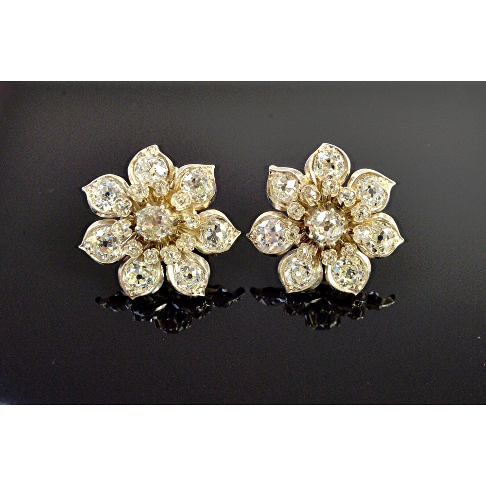 A pair of diamond set earclips, each... Image