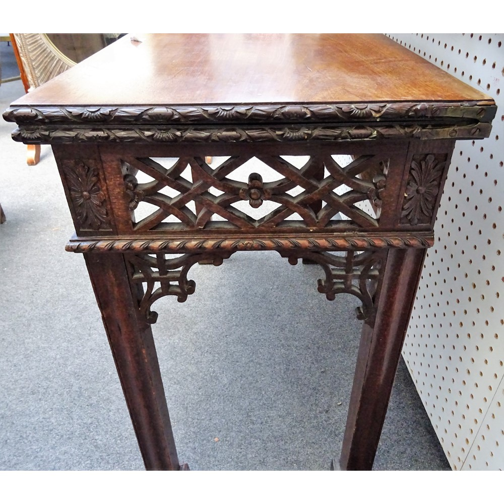 A pair of 19th century Chippendale revival mahogany card tables, each with rectangular foldover... Image