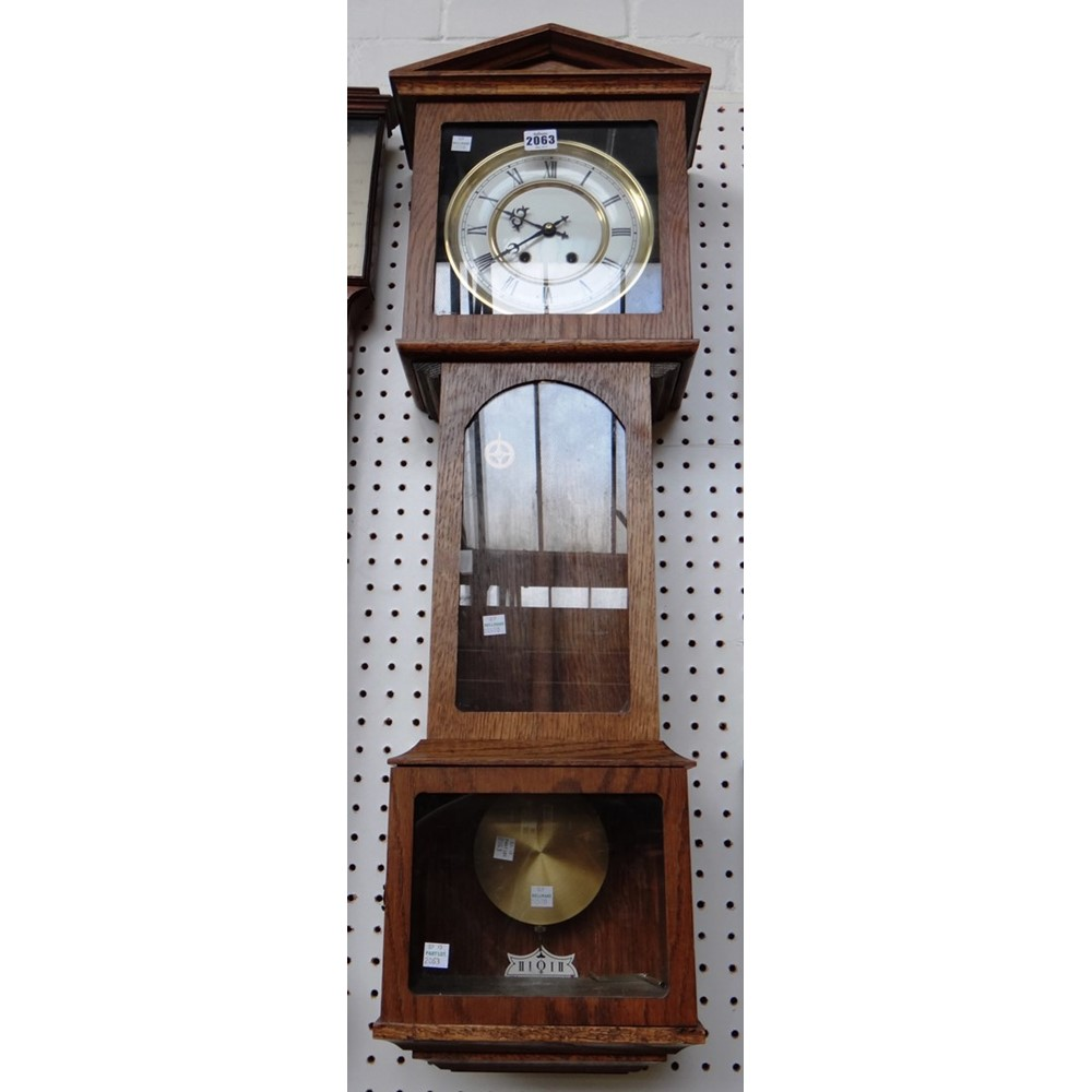 A wall clock with regulated escapement,... Image