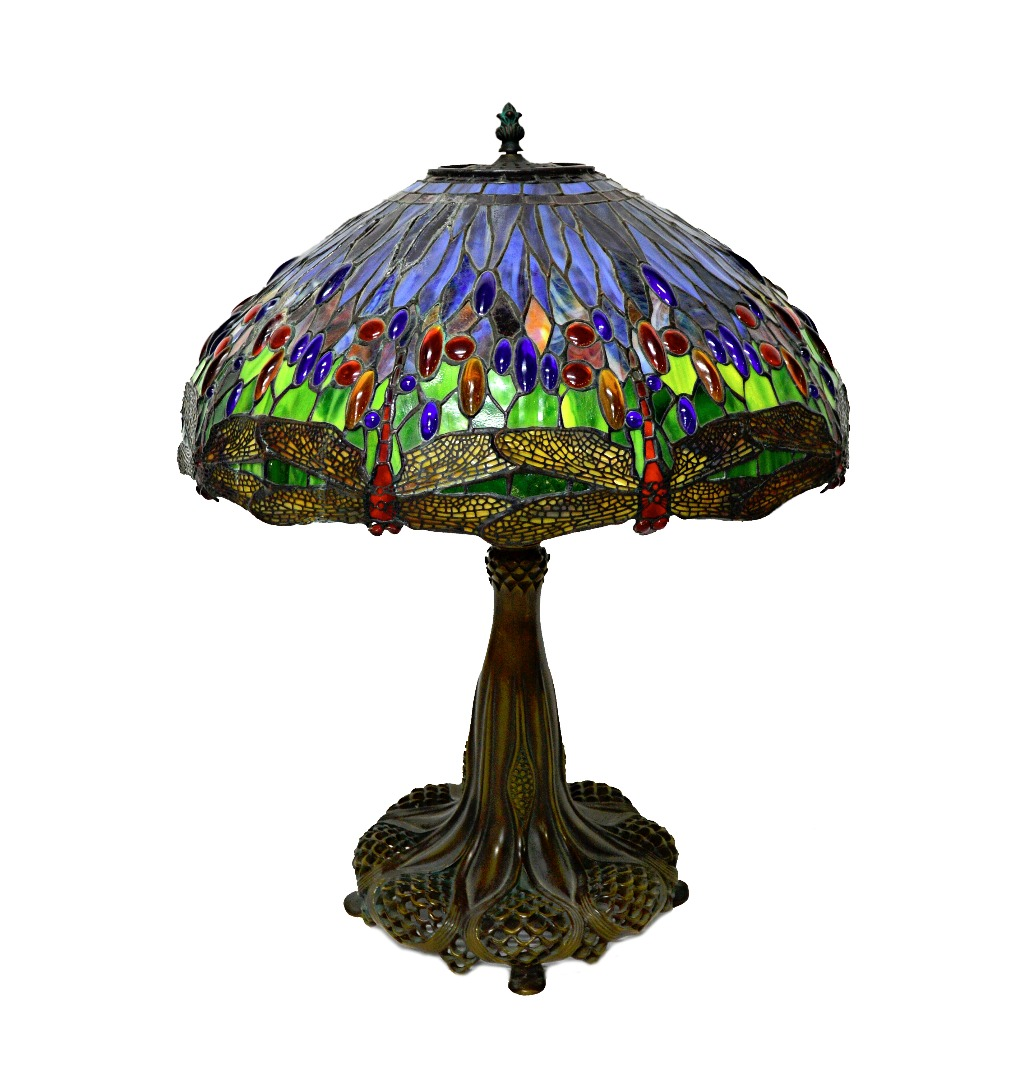 A bronze and coloured glass Tiffany... Image