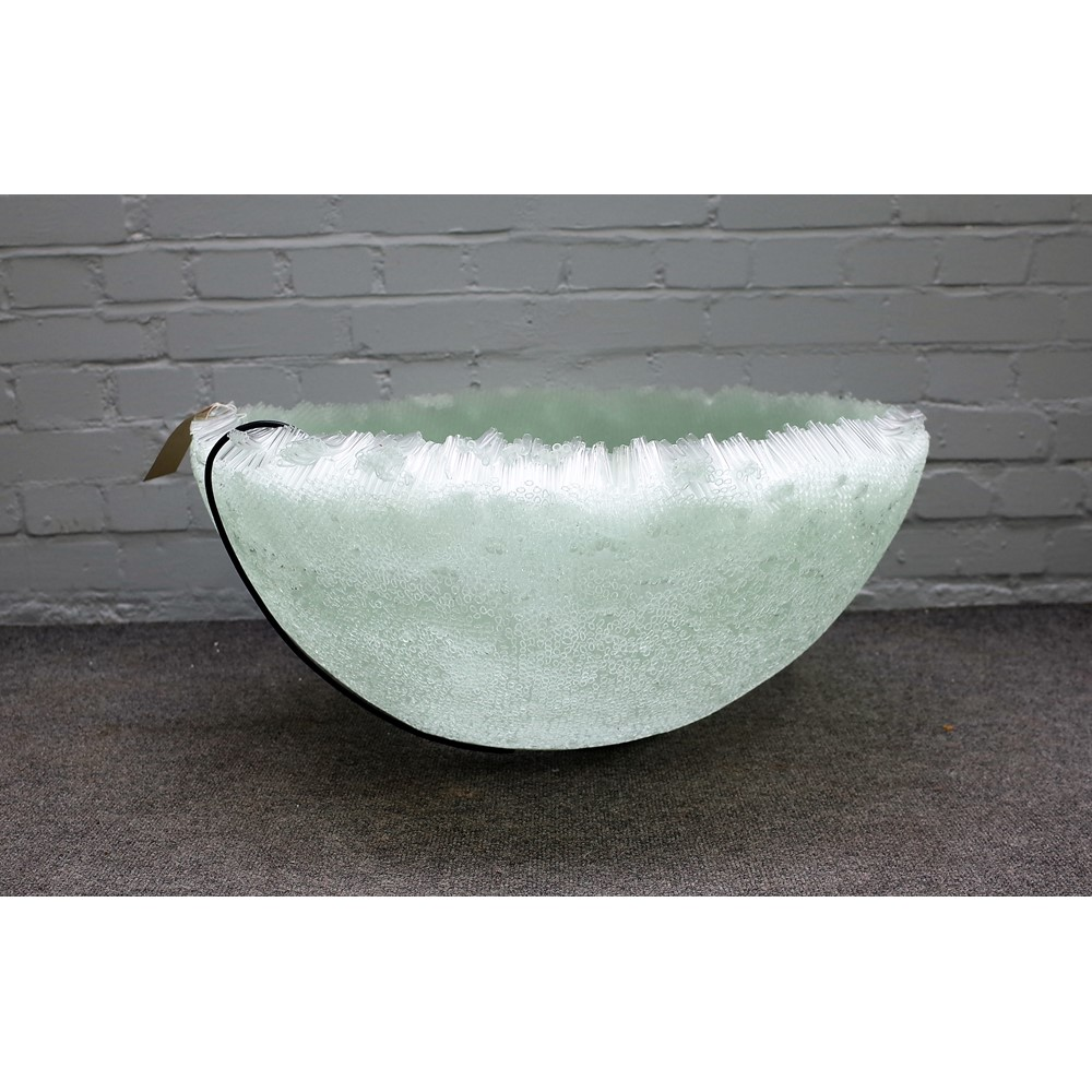 A large modern glass centrepiece of circular bowl form, the body made up of small hollow glass... Image