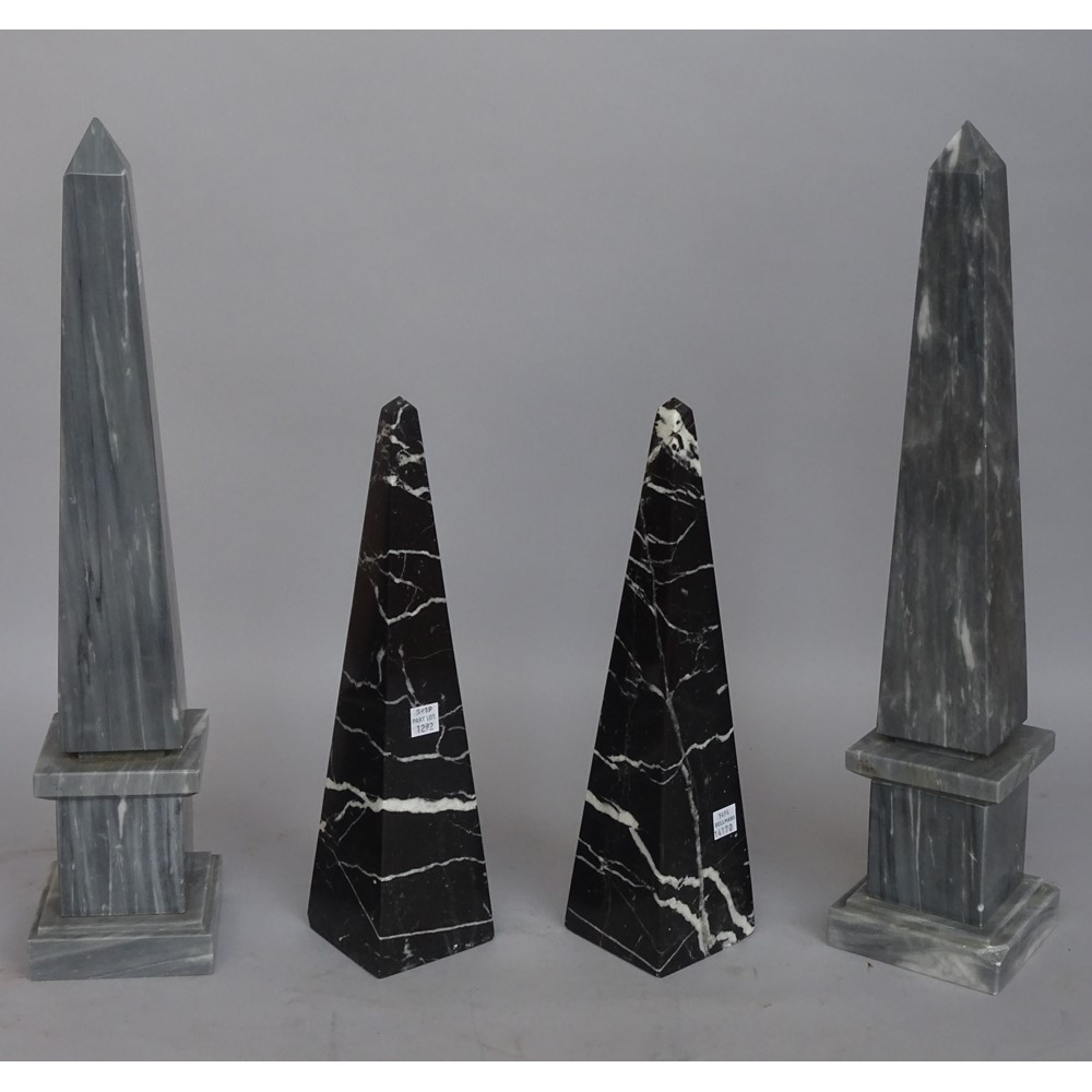 A pair of grey marble obelisks, raised on a stepped square plinth and a pair of smaller black... Image