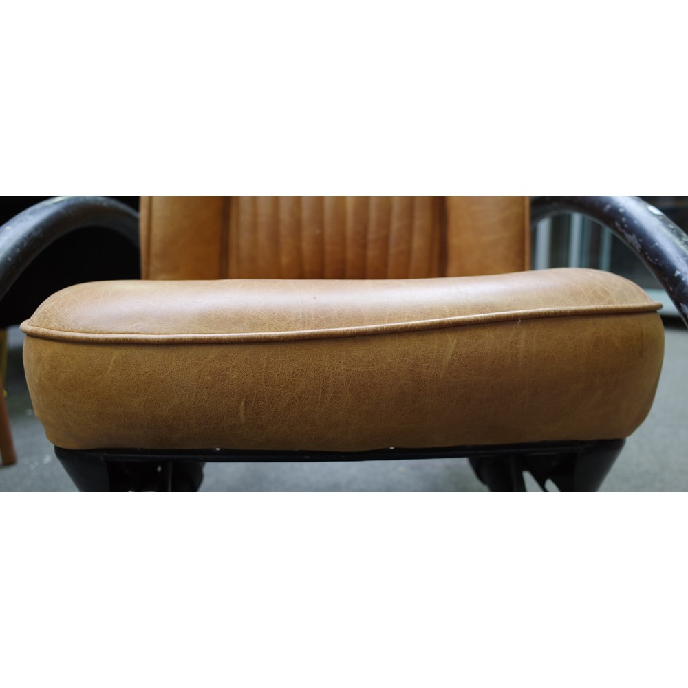Ron Arad; a pair of Rover chairs, circa 1989, in tan leather upholstery, 70cm wide x 102cm high,... Image