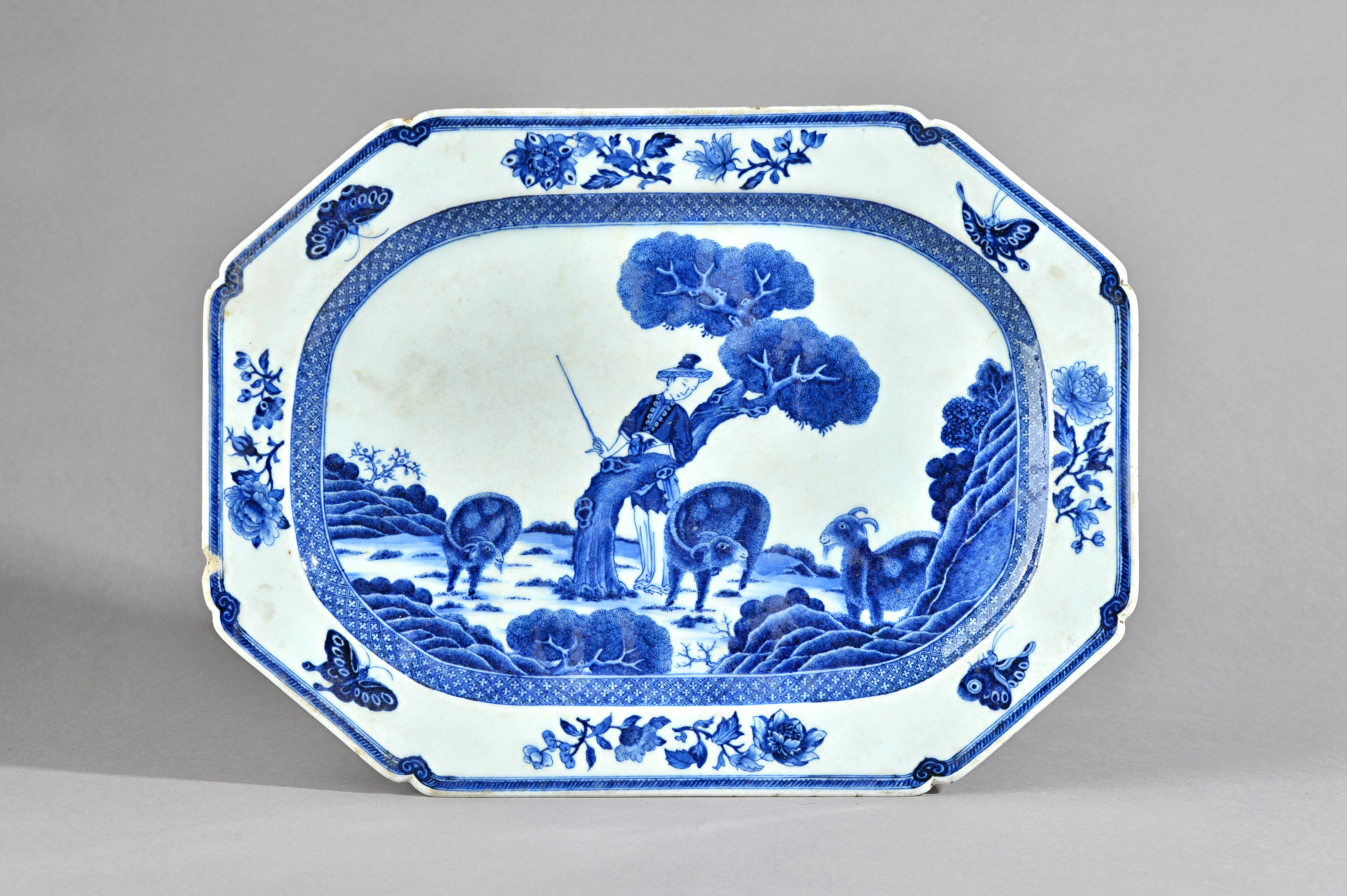 A Chinese export blue and white part service, early 19th century, painted in the centre with a... Image