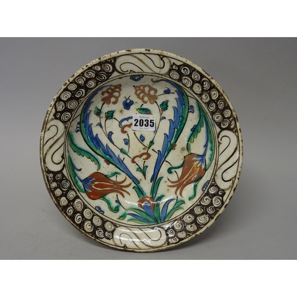 An Iznik pottery dish, Ottoman Anatolia, first half 17th century, painted with polychrome tuilp,... Image