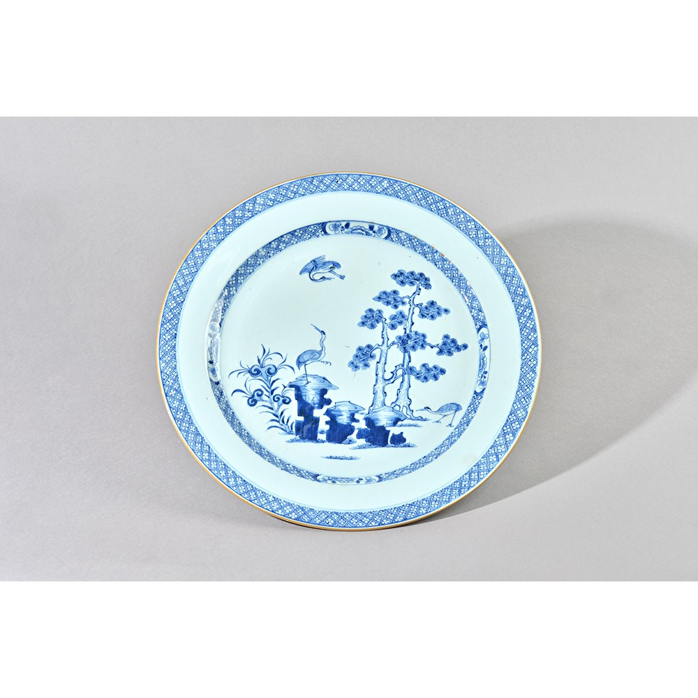 A pair of large Chinese export blue and white plates, Qianlong, each painted in the centre with... Image
