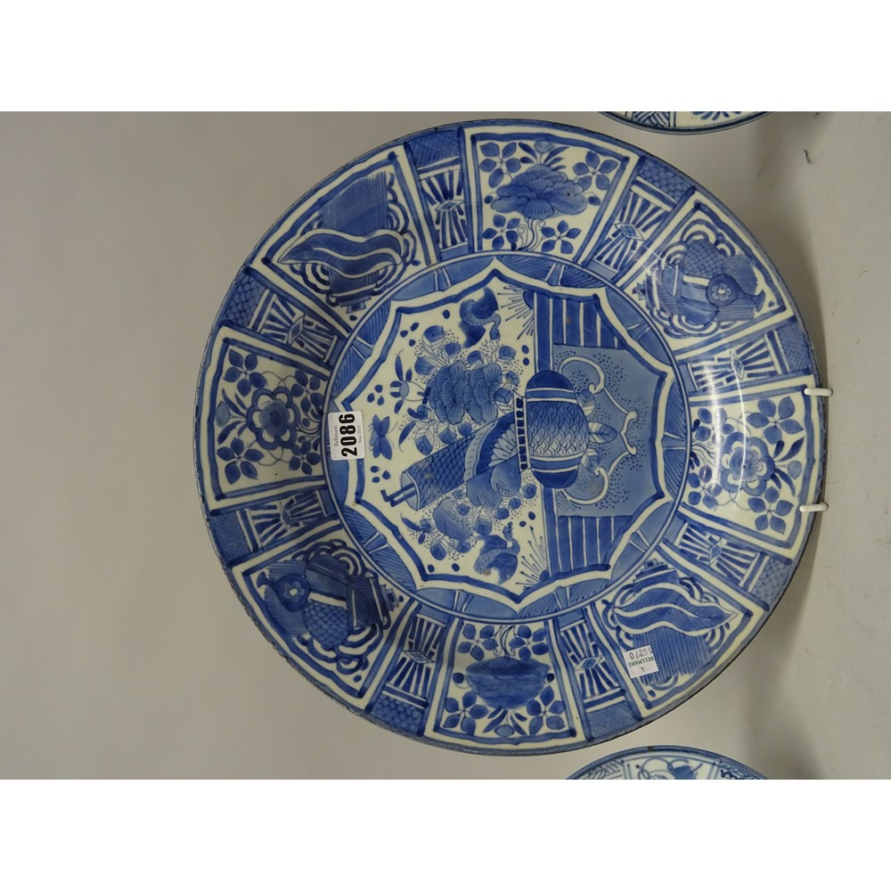 A Japanese  blue and white dish in kraak porcelain style, probably 19th century, painted in the... Image