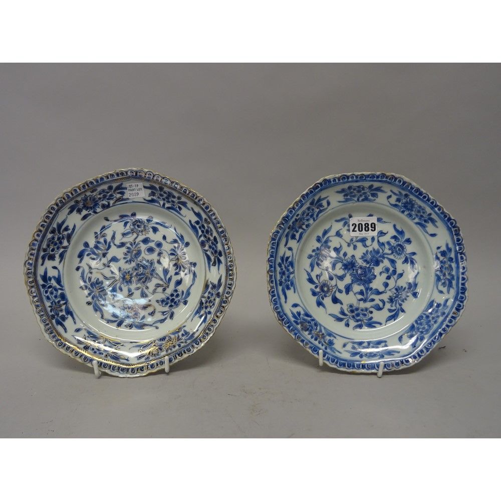 A pair of Chinese porcelain hexagonal plates, 18th century, painted in underglaze-blue and picked... Image