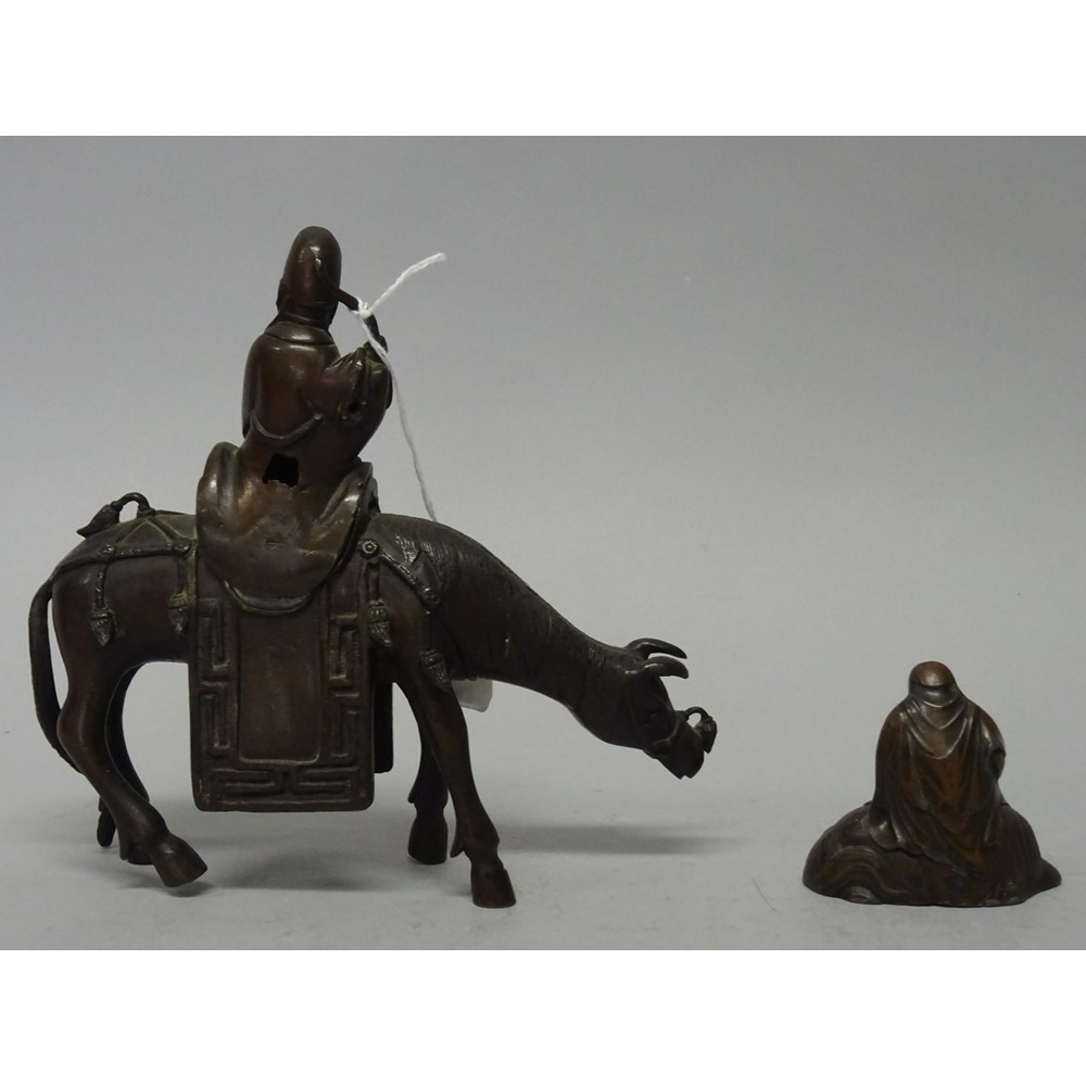 A Chinese bronze censer and cover, 18th/19th century, in the form of the poet Du Fu seated on a... Image