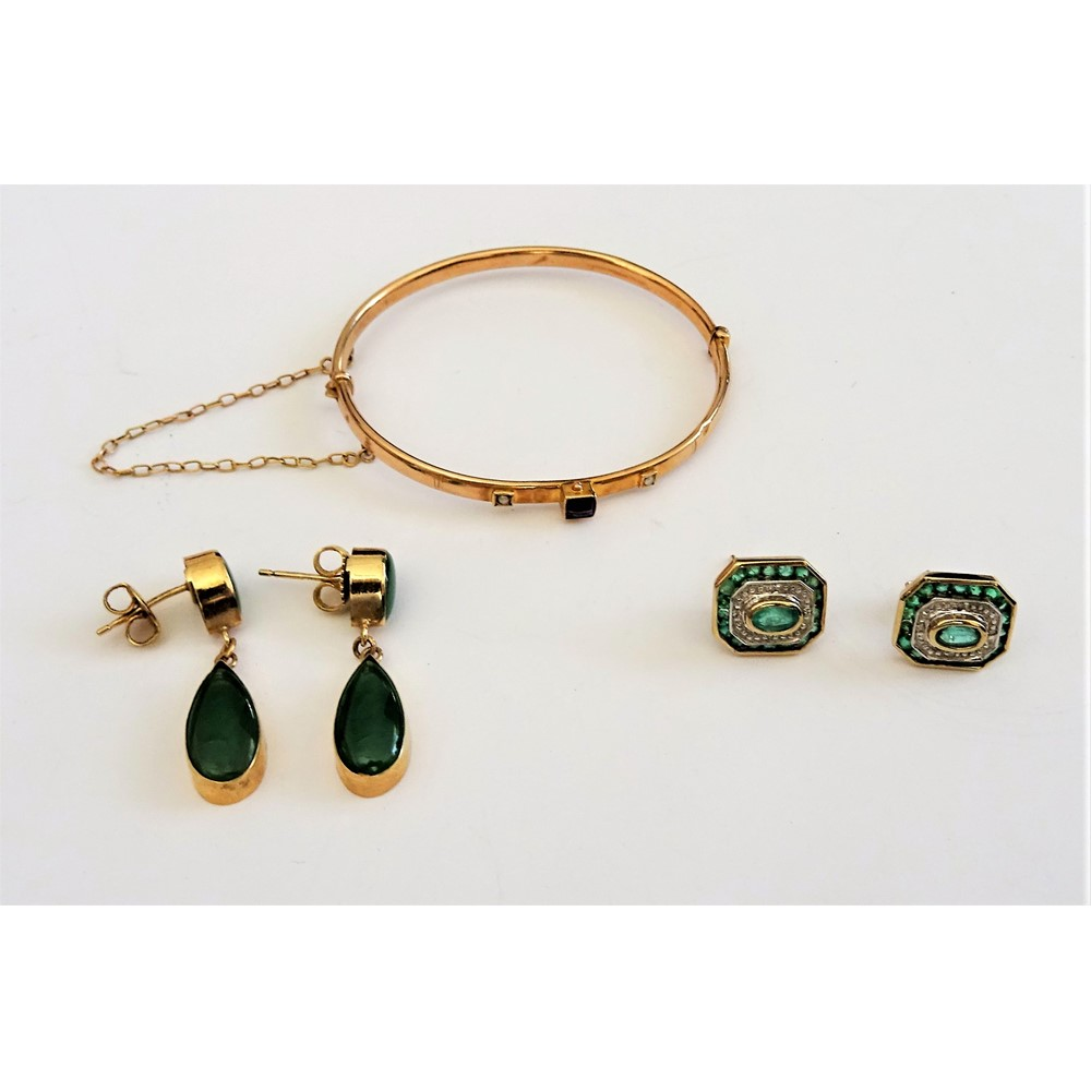 A pair of 9ct gold, emerald and diamond earstuds, each in a cut cornered rectangular design,... Image