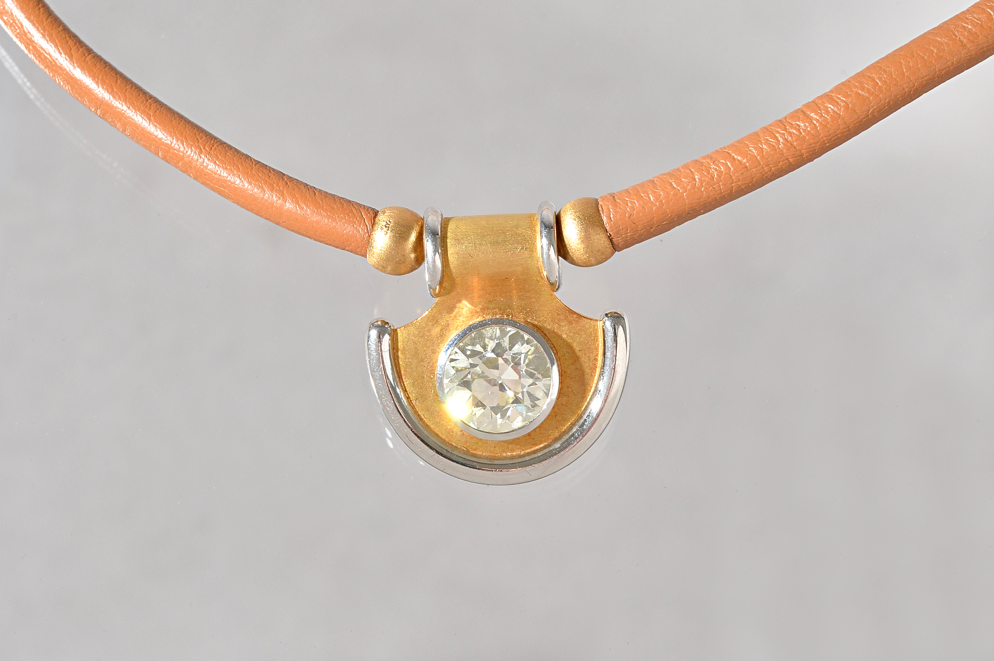 A Kunz of Switzerland gold and pale brown leather collar necklace, the two colour semi-circular... Image