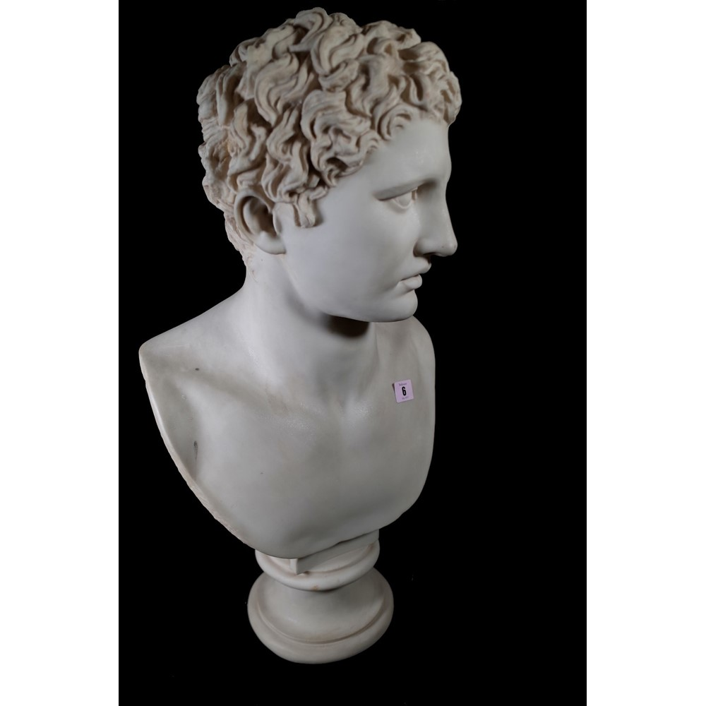 After the Antique; a modern resin bust depicting a Roman man, on turned socle, 64cm high. This... Image