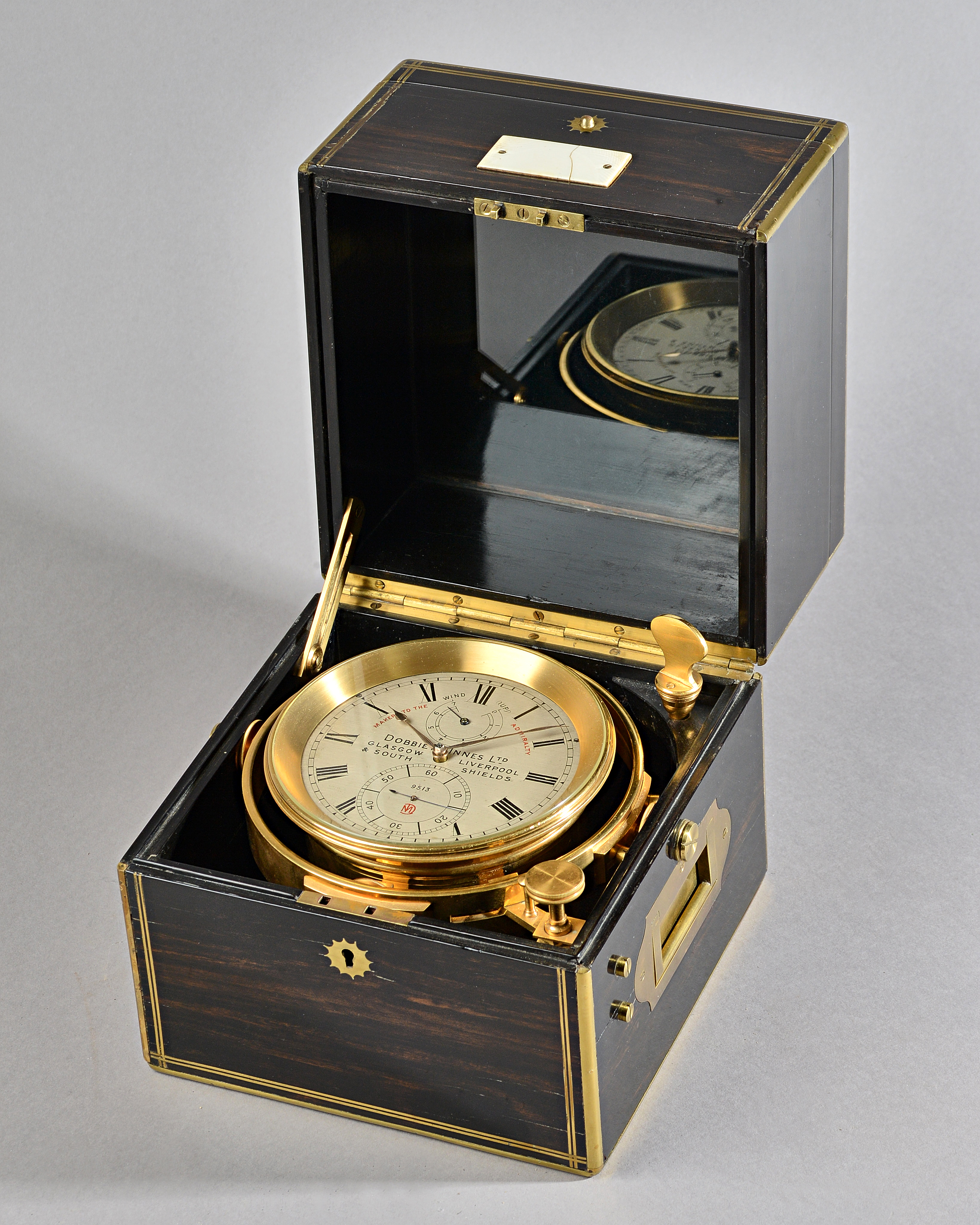 A Fine brass-mounted calamander eight-day marine chronometer with Poole's auxillary compensation Image