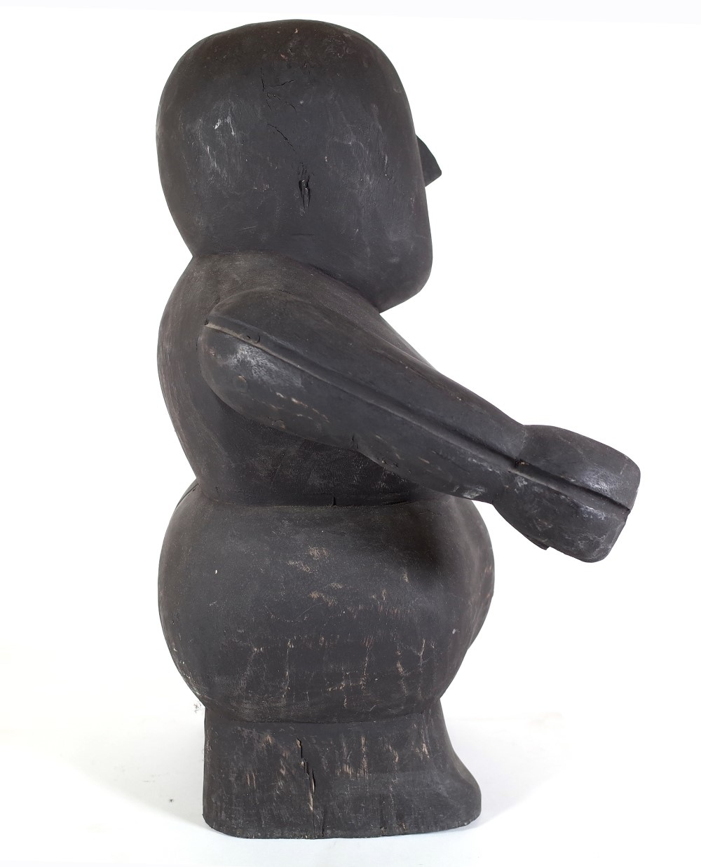 A 20th century ebonised hardwood tribal style carved figure of a woman, 49cms high.This lot has... Image