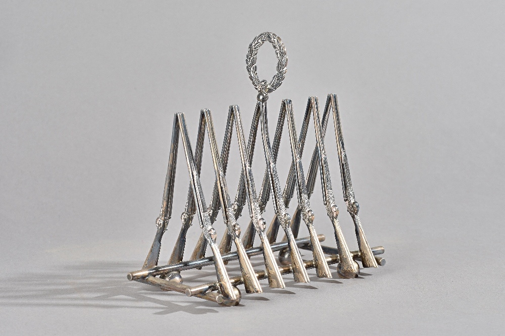 Holland & Holland; a late 20th century six division silver toastrack, modelled as seven pairs of... Image