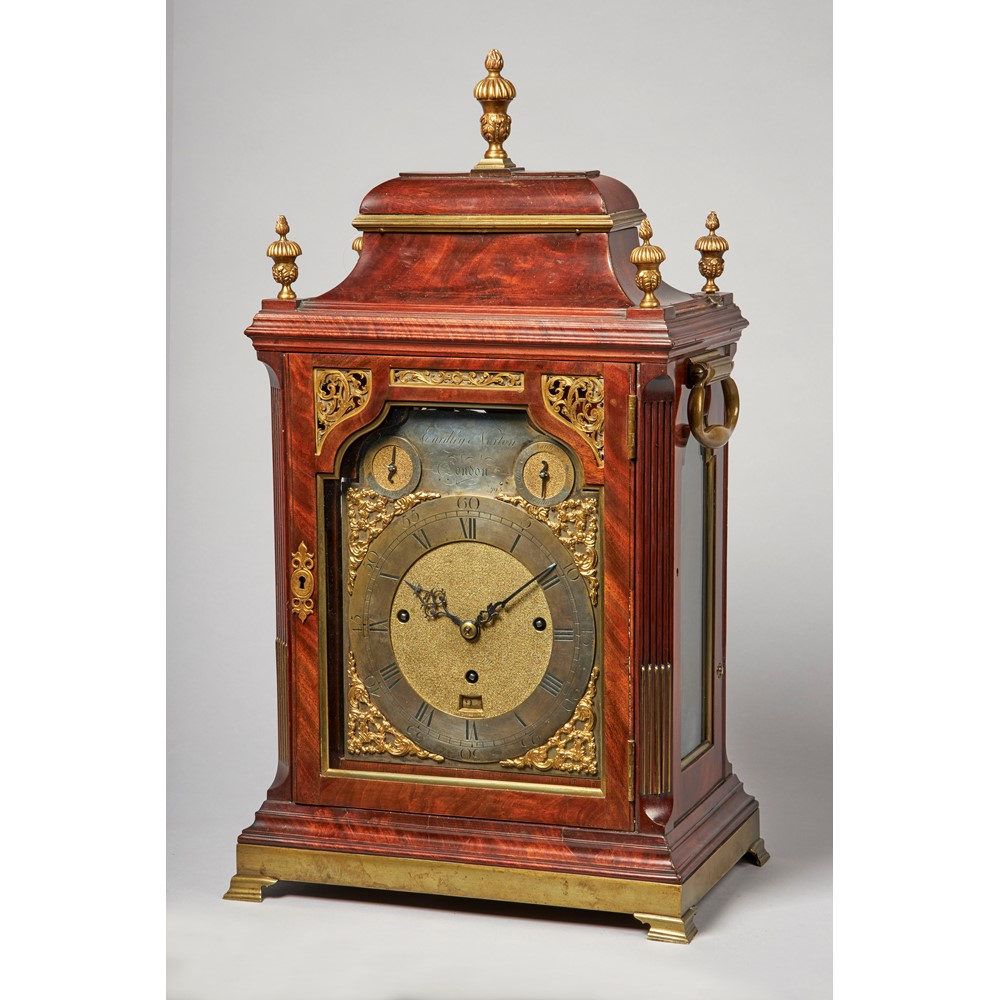 A GEORGE III GILT-BRASS-MOUNTED MAHOGANY QUARTER-CHIMING MUSICAL TABLE CLOCK Image
