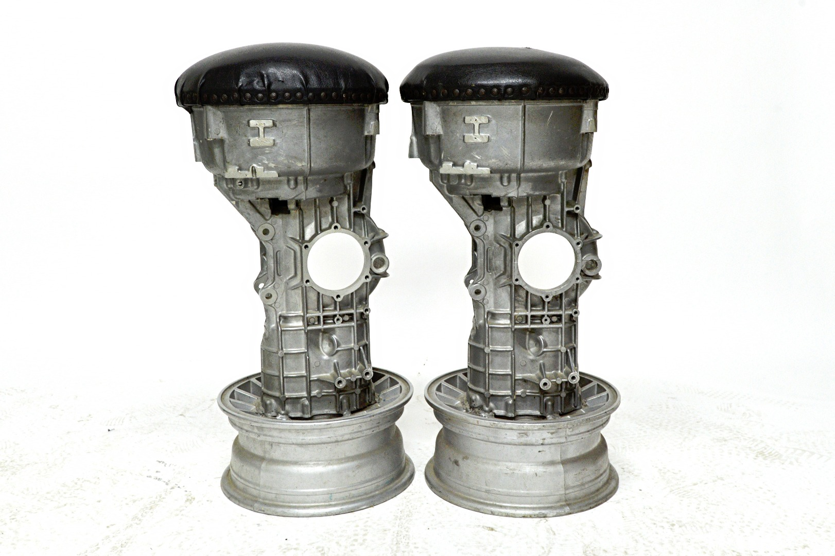 A pair of 20th century bar stools, the... Image