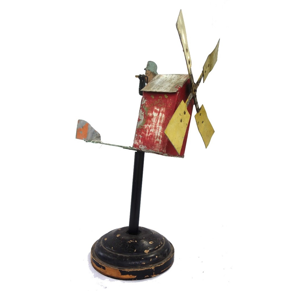 A tin figural whirligig, early 20th... Image