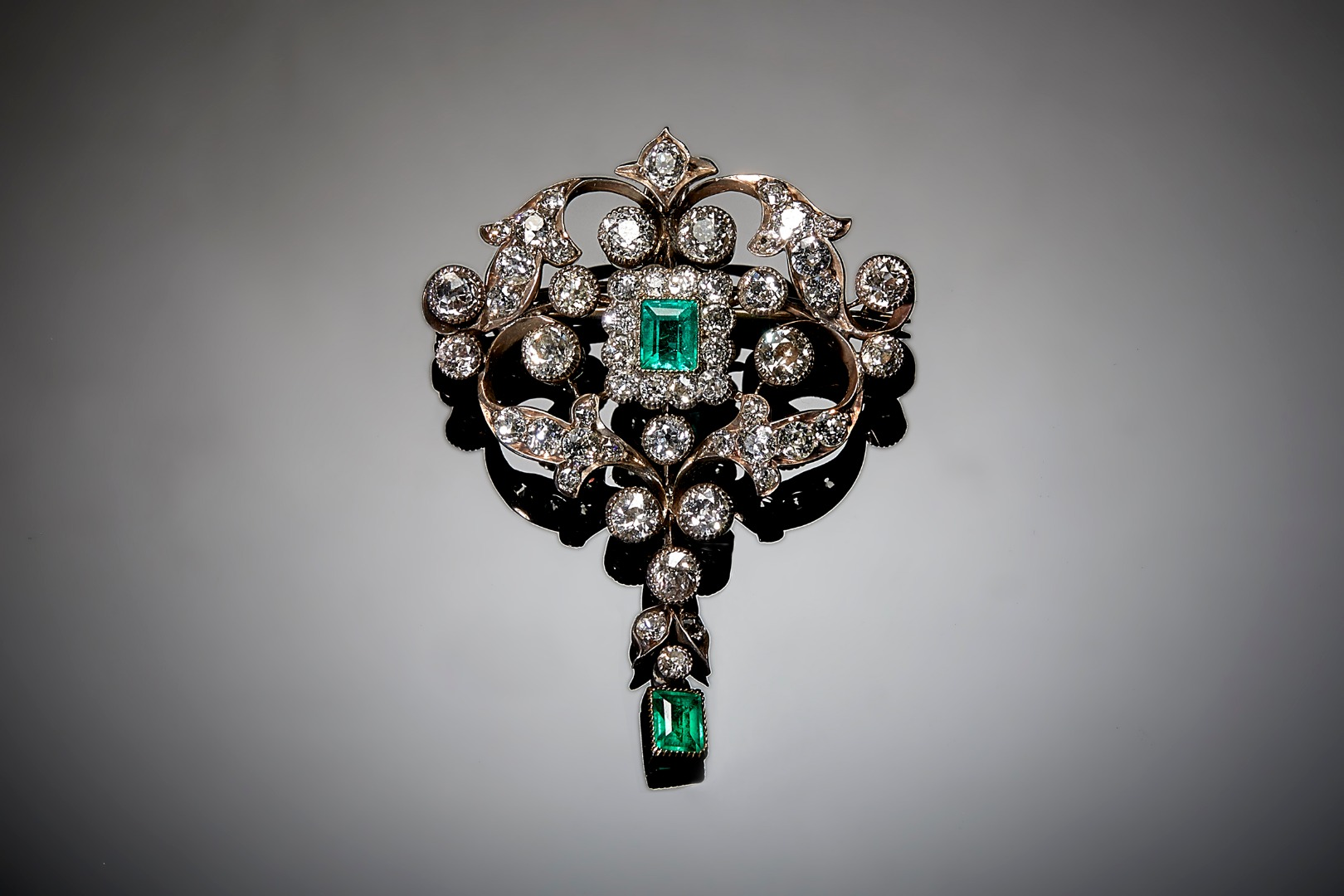 A diamond and emerald set pendant... Image