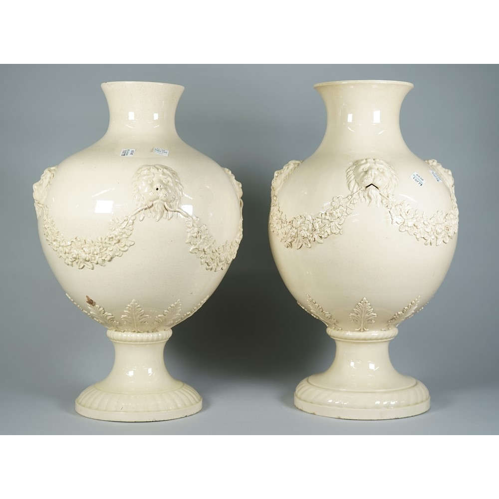 A near pair of large Wedgwood creamware baluster vases, circa 1767, each bulbous body applied... Image
