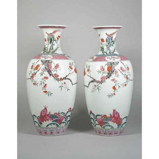 A pair of Chinese famille-rose vases, 19th century, each ovoid body finely enamelled with two... Image