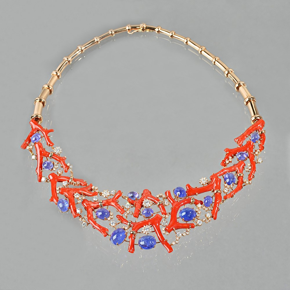 A gold, coral, amethyst and diamond set parure, the articulated collar necklace, claw set with a... Image