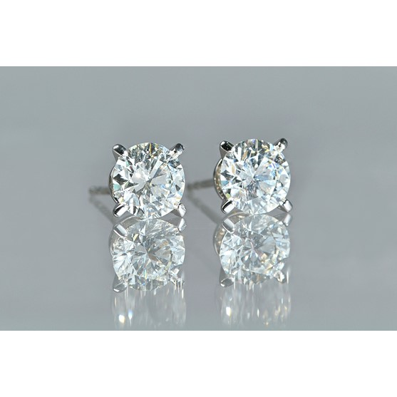A pair of solitaire diamond earstuds, the brilliant cut diamonds each accompanied with a copy of... Image