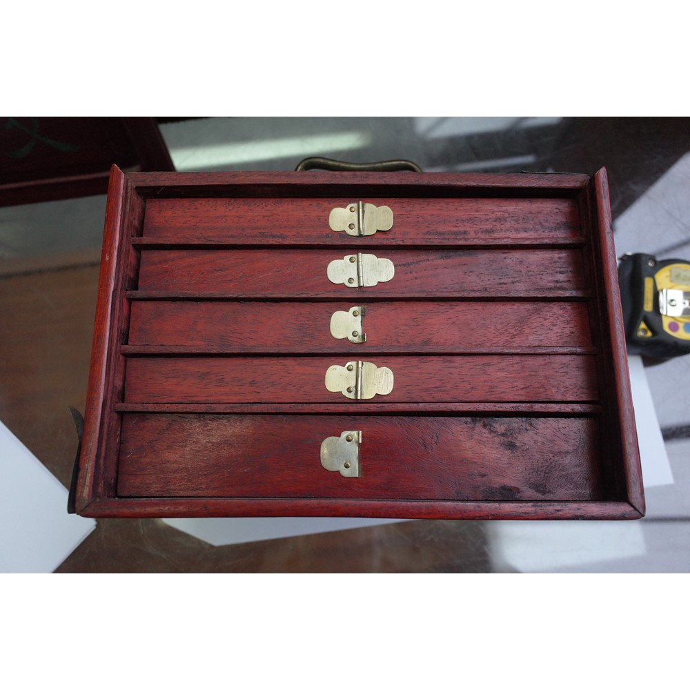 A 20th century Chinese bone and bamboo Mahjong set in a red stained wood case fitted with five... Image