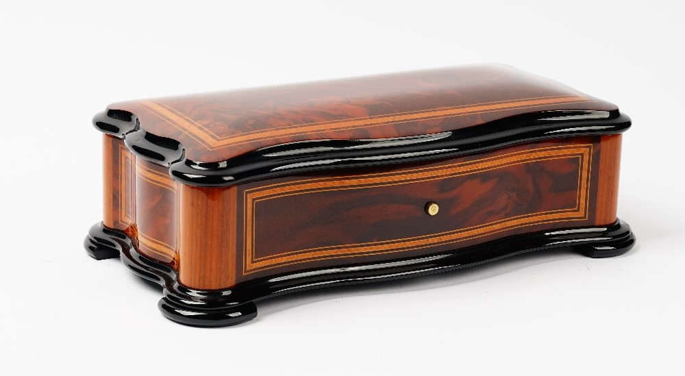 Reuge Music, Saint-Croix, a Swiss walnut and inlaid cylinder music box, the nine inch roller... Image