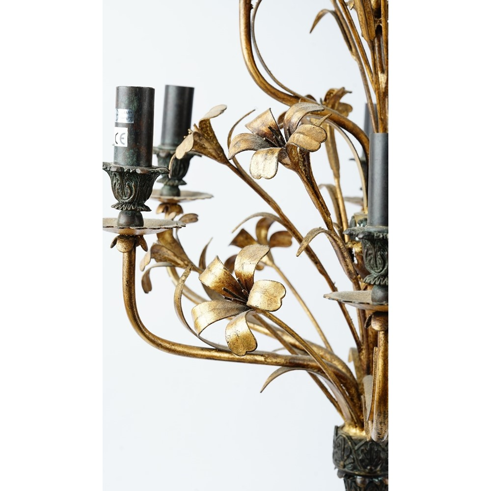 A large modern tole peinte black and gilt ten branch candelabra, 120cm high. Image